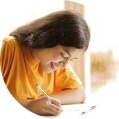 woman-in-yellow-shirt-writing-on-white-paper-3807755