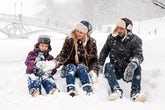 woman-man-and-girl-sitting-on-snow-1620653